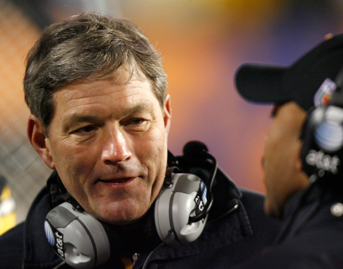 Iowa head coach Kirk Ferentz speaks with an assistant coach on the sidelines during his team's play against Georgia Tech in the FedEx Orange Bowl BCS NCAA football game in Miami