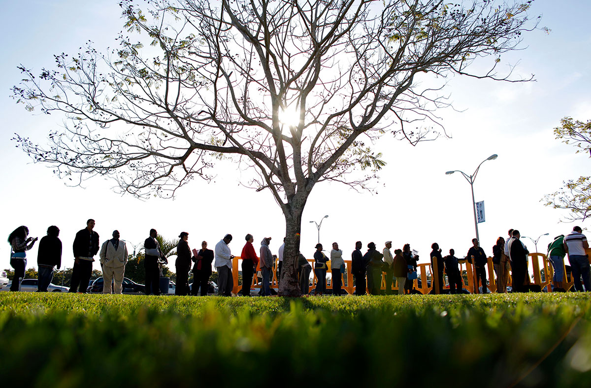 People wait in line looking for jobs during a Job Fair at the Miami Dade College in Miami, Florida