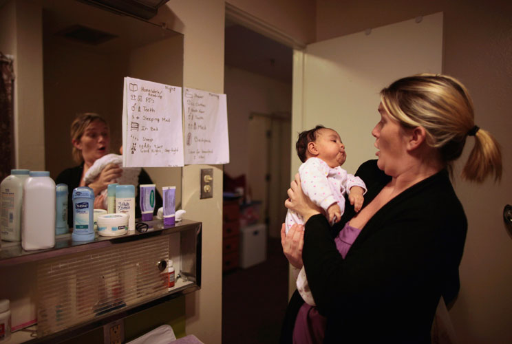 Doreen Earp, 38, of Germany looks at her five-week-old daughter Emily in their apartment at Hope Gardens Family Center, which is run by Union Rescue Mission on 77 acres of countryside near Los Angeles, California.