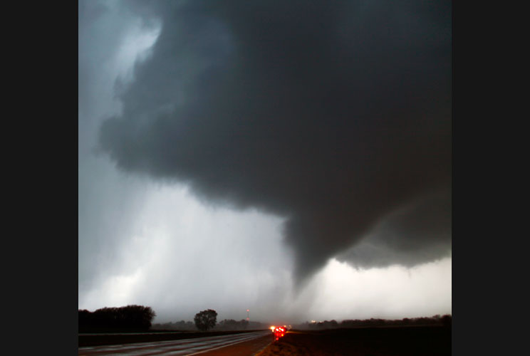 A tornado makes its way over the 135 freeway near Moundridge, Kansas, on April 14, the third day of severe weather and multiple tornado sightings. A spate of tornadoes tore through parts of Oklahoma, Kansas, Nebraska and Iowa, churning through Wichita and