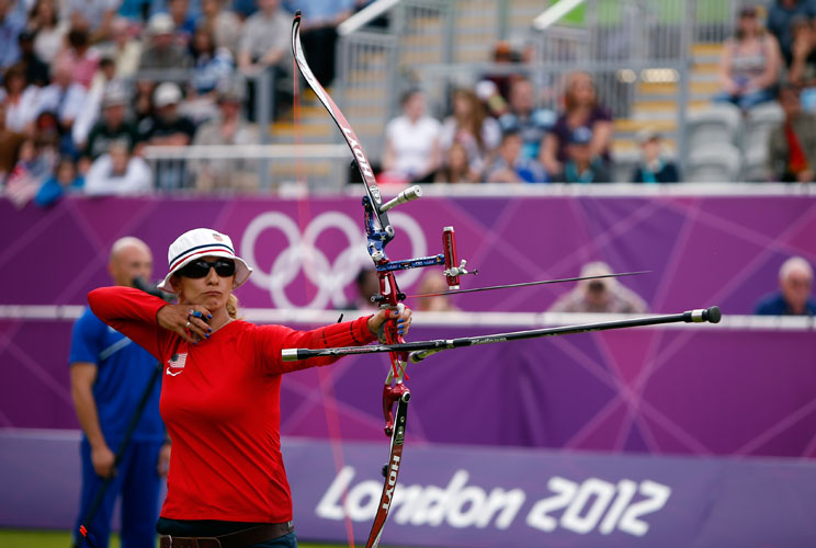 How much can a bow and arrow cost? After all, it was the choice weapon of Robin Hood, guardian of the poor. But today, archery can set competitors back $2,000 in equipment costs. An Olympian archer typically trains by shooting 250 shots a day, six days a