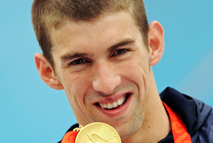 MICHAEL PHELPS GOLD MEDAL - 4th of 8Michael Phelps of the U.S holds his gold medal after winning the men's 200 meters butterfly swimming final at the National Aquatics Center during the Beijing 2008 Olympic Games August 13, 2008. Phelps swam his way into
