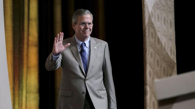 """Republican presidential candidate Jeb Bush waves as he arrives to address a legislative luncheon held as part of the """"Road to Majority"""" conference in Washington"""