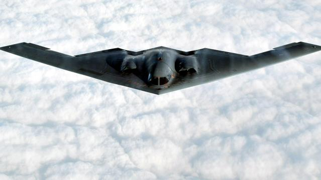 The B-2 Spirit stealth bomber flies over the Missouri Sky after taking off from the Whiteman Air For..