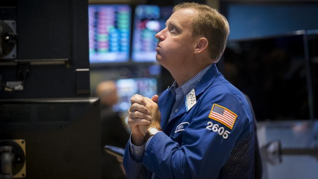Specialist trader Zelles works at his post on the floor of the New York Stock Exchange