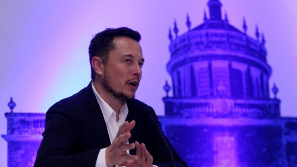 Elon Musk talks up safety, talks down market cap