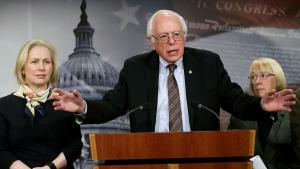 Senator Bernie Sanders (I-VT) speaks between Senators Kirsten Gillibrand (D-NY) and Patty Murray (D-WA) during a news conference to unveil the FAMILY Act on Capitol Hill in Washington