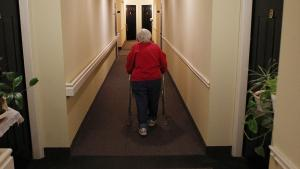 Inez Willis walks down the hallway to visit a neighbor at her independent living complex in Maryland