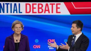 Democratic presidential candidate Senator Elizabeth Warren listens as South Bend Mayor Pete Buttigieg speaks during the fourth U.S. Democratic presidential candidates 2020 election debate in Westerville, Ohio