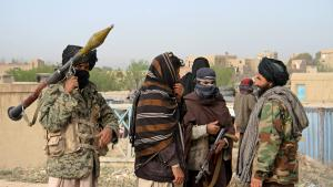 File picture of members of the Taliban at the site of the execution of three men accused of murdering a couple during a robbery in Ghazni Province