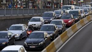 Cars are seen stuck in a traffic jam on a road heading towards central Brussels during the morning rush hour