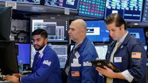 Traders work on the floor of the New York Stock Exchange (NYSE) in New York, U.S., April 19, 2017. REUTERS/Brendan McDermid