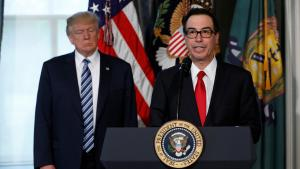 U.S. President Donald Trump (L) greets Treasury Secretary Steven Mnuchin during an event to sign financial services executive orders at the Treasury Department in Washington, U.S., April 21, 2017. REUTERS/Kevin Lamarque