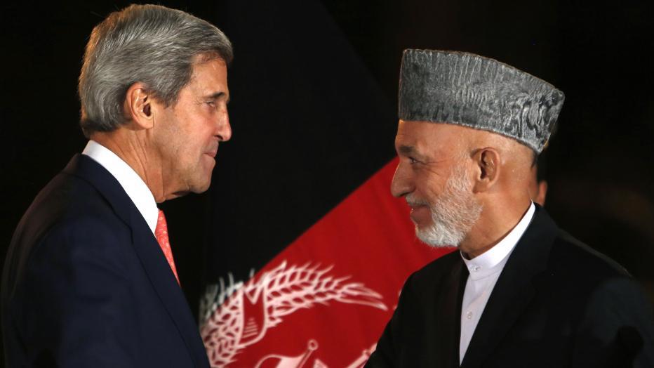 John Kerry and Hamid Karzai