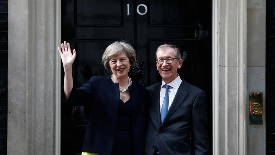 Britain's Prime Minister, Theresa May, and husband Philip pose for the media outside number 10 Downing Street, in central London
