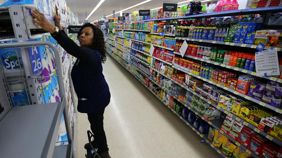 Mamie Penn works sorting shelving displays as workers prepare for the opening of a Walmart Super Center in  Compton, California