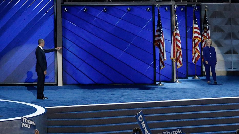 U.S. President Barack Obama points to Democratic presidential nominee Hillary Clinton as she walks on stage on the third day of the Democratic National Convention in Philadelphia