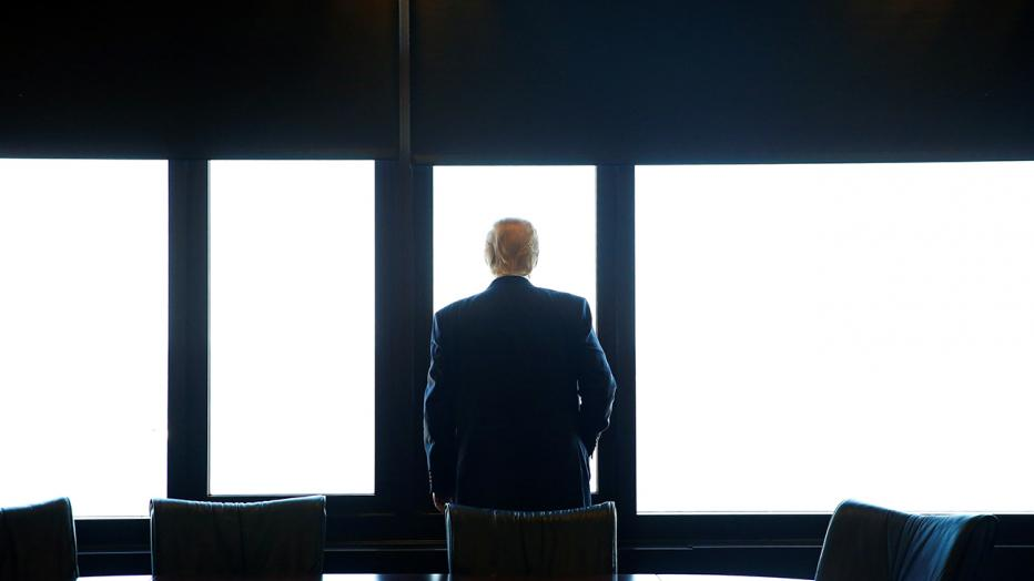 Republican U.S. presidential nominee Donald Trump looks out at Lake Michigan during a visit to the Milwaukee County War Memorial Center in Milwaukee, Wisconsin