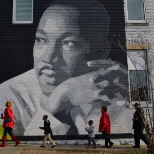 People gather to march in the annual parade down MLK Boulevard to honor Martin Luther King, in Chattanooga, Tennessee