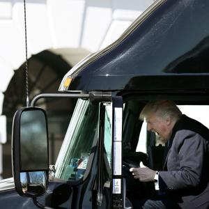 U.S. President Donald Trump reacts as he sits on a truck while he welcomes truckers and CEOs to attend a meeting regarding healthcare at the White House in Washington, U.S.