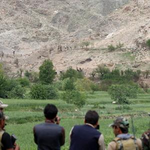 Afghan Special Forces watch at the site where a MOAB, or ''mother of all bombs'', struck the Achin district of the eastern province of Nangarhar, Afghanistan