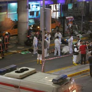 Forensic experts work outside Turkey's largest airport, Istanbul Ataturk, Turkey, following a blast