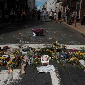 Flowers and a photo of car ramming victim Heather Heyer lie at a makeshift memorial in Charlottesville