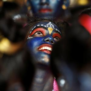 Students participate in celebrations ahead of the Janmashtami festival, which marks the birth anniversary of Lord Krishna in Mumbai