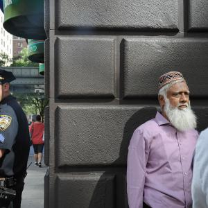A member of the New York City police stands guard before the start of the annual Muslim Day Parade in the Manhattan borough of New York City