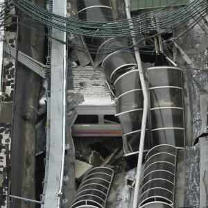 A derailed New Jersey Transit train is seen under a collapsed roof after it derailed and crashed into the station in Hoboken, New Jersey
