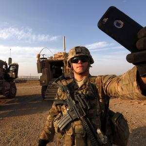 An American soldier takes a selfie at the U.S. army base in Qayyara, south of Mosul