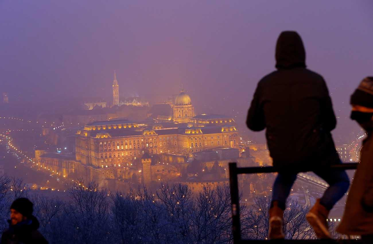 The Royal Castle is seen under a veil of heavy winter smog in Budapest