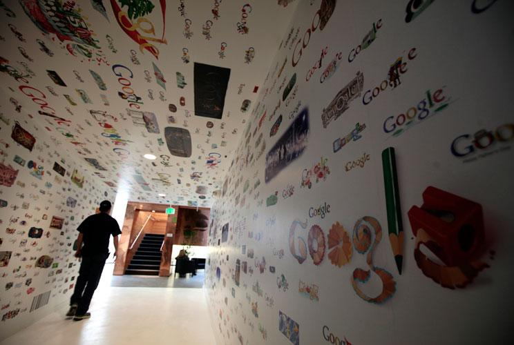 A man walks through a tunnel of Google homepage logos at the Google campus near Venice Beach, in Los Angeles, California January 13, 2012. The 100,000 square-foot campus has around 500 employees who develop video advertising for YouTube, parts of the Goog