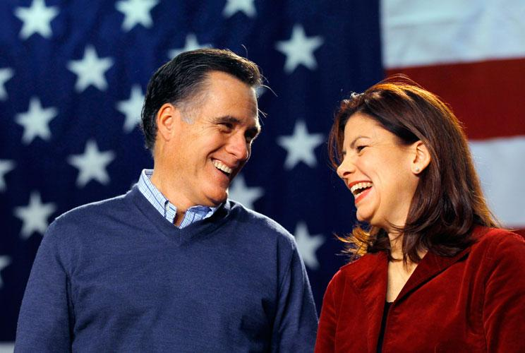 Republican presidential candidate and former Massachusetts Governor Mitt Romney (L) shares a laugh with U.S. Senator Kelly Ayotte (R-NH) during a campaign stop at Pinkerton Academy in Derry, New Hampshire January 7, 2012.