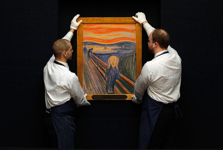 "Sotheby's employees pose with Edvard Munch's ""The Scream"" at the auction house in London, April 12, 2012. The painting, estimated to exceed $80 million (50.2 million pounds), broke a world record in New York on May 2, 2012, becoming the most expensive pai"