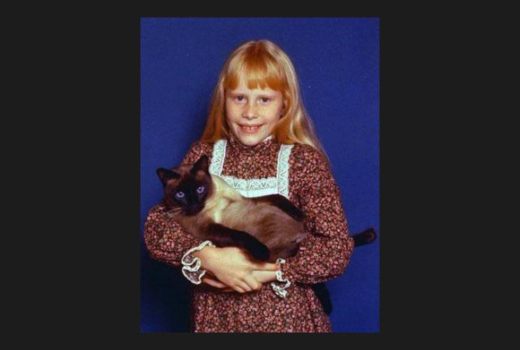 Amy Carter, daughter of Jimmy Carter (1977-81), holds her Siamese cat, Misty Malarky Ying Yang.