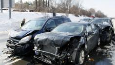 Smashed cars litter at the scene of an earlier multi-car and truck pile up the Pennsylvania Turnpike near the Bensalem interchange in Pennsylvania