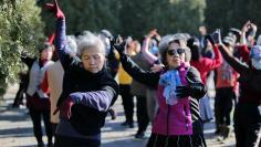 Women dance in a park in Beijing