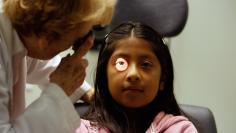 Uninsured patient has eye test at clinic in California