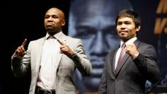Manny Pacquiao and Floyd Mayweather pose at a news conference for their upcoming bout in Los Angeles