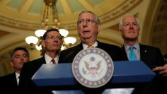 Senate Majority Leader Mitch McConnell, accompanied by Sen. Cory Gardner (R-CO), Sen. John Barrasso (R-WY) and Sen. John Cornyn (R-TX), speaks to the media following the weekly policy luncheons on Capitol Hill in Washington