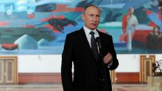 Russian President Putin speaks to reporters during visit for summit of former Soviet republics at Manas airport outside Bishkek