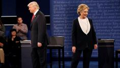 Republican U.S. presidential nominee Donald Trump and Democratic U.S. presidential nominee Hillary Clinton appear together during their presidential town hall debate at Washington University in St. Louis