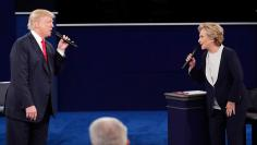 Republican U.S. presidential nominee Donald Trump and Democratic U.S. presidential nominee Hillary Clinton speak during their presidential town hall debate at Washington University in St. Louis