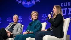 Bill Clinton and Hillary Clinton watch their daughter discuss how she was raised in Temp