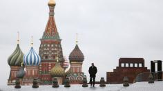 A man walks along Red Square in Moscow