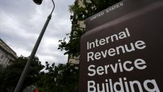 A security camera hangs near a corner of the Internal Revenue Service (IRS) building in Washington