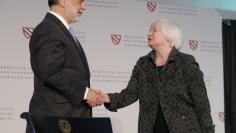 Federal Reserve Chair Janet Yellen is welcomed by former Federal Reserve Chairman Ben Bernanke at Harvard University in Cambridge, Massachusetts