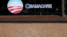 FILE PHOTO: A sign on an insurance store advertises Obamacare in San Ysidro