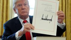 FILE PHOTO:  U.S. President Trump displays signature after signing tax bill into law at the White House in Washington